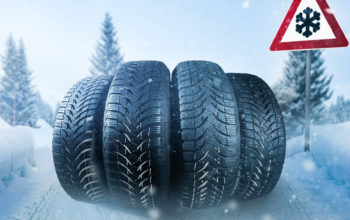 Car tires on a snow covered roadway