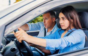 woman-student-driver-sitting-scared-in-car-with-instructor